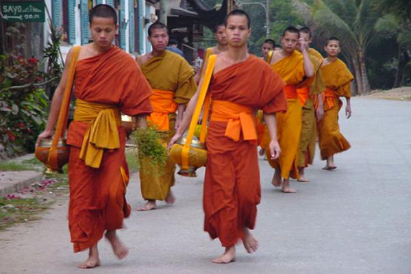 Picture of Collecting food in the early morningLao Monks - Laos