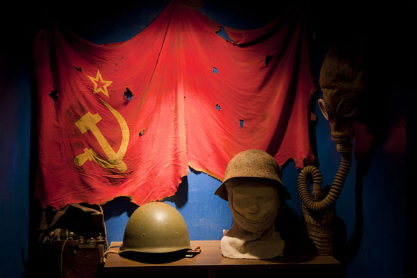 Picture of Helmets and Soviet flag in the small museum of the former military prison of Karosta