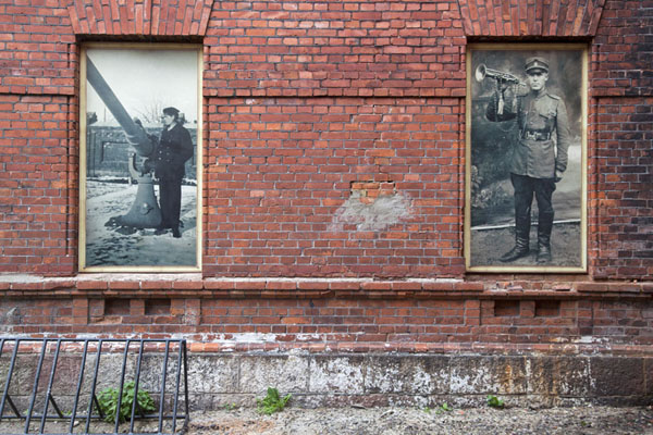 Old black-and-white pictures on a wall of the former military prison of Karosta | Karosta Military Prison | Latvia