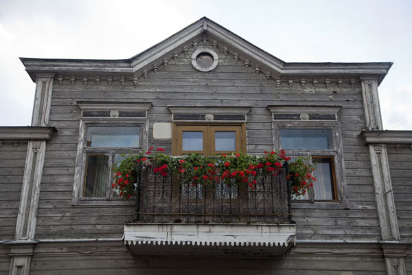 Picture of Flowers hanging from a traditional wooden house in Kuldīga
