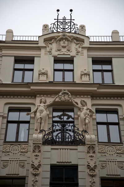 Looking up one of the richly decorated facades of a building in the old town of Riga | Riga Old Town | Latvia
