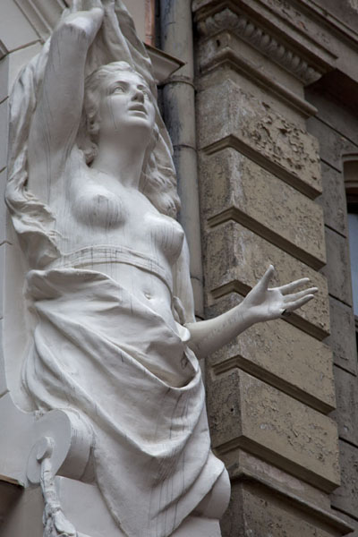 Detail of sculpture of woman on a facade of a building in the old town of Riga | Riga Old Town | Latvia