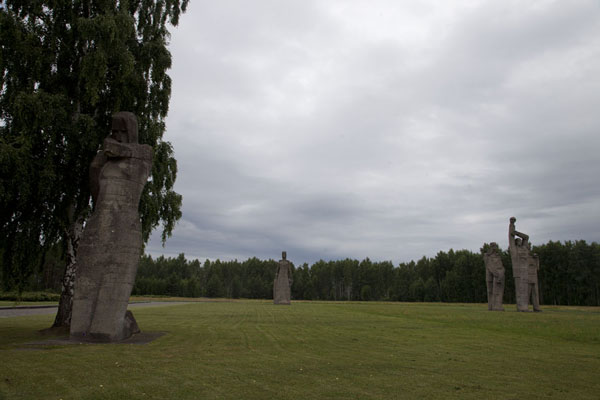 Picture of Salaspils concentration camp (Latvia): Massive statues scattered around the field of the concentration camp, with the Defeated in the foreground