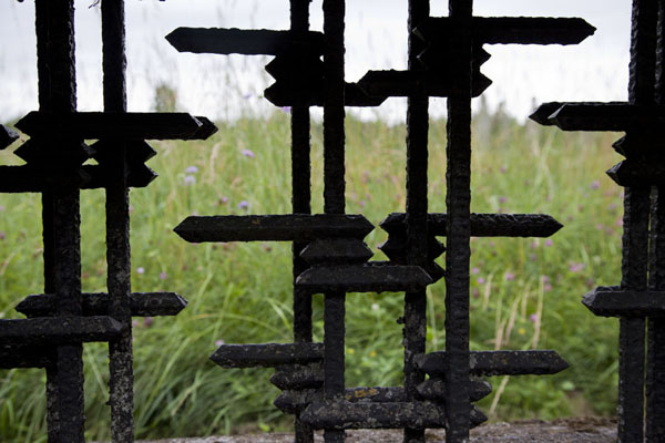 Looking through bars once used in the barracks | Salaspils concentration camp | Latvia