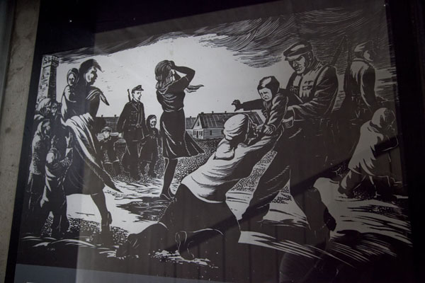 Picture of Salaspils concentration camp (Latvia): Black and white drawing of a scene involving Nazis on display in the small museum