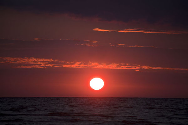 Picture of Slītere National Park (Latvia): The sun is about to touch the horizon over the Baltic Sea at Cape Kolka