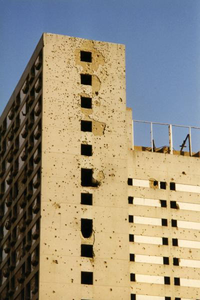 Picture of Beirut (Lebanon): Countless bullet holes in a wall of a tall building in Beirut