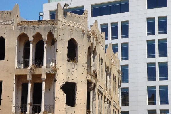 Picture of New Beyrut (Lebanon): Bullet-ridden house in contrast with a modern building, Central District, Beyrut