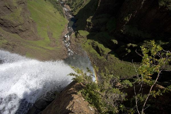 Picture of Maletsunyane river falling down towards its own rainbow