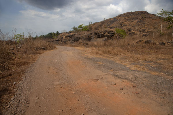 Foto di Track above Blue Lake with hill - Liberia - Africa