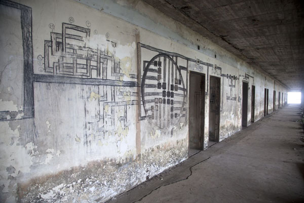 Corridor with schematic drawings on the wall | Ducor Palace Hotel | Liberia