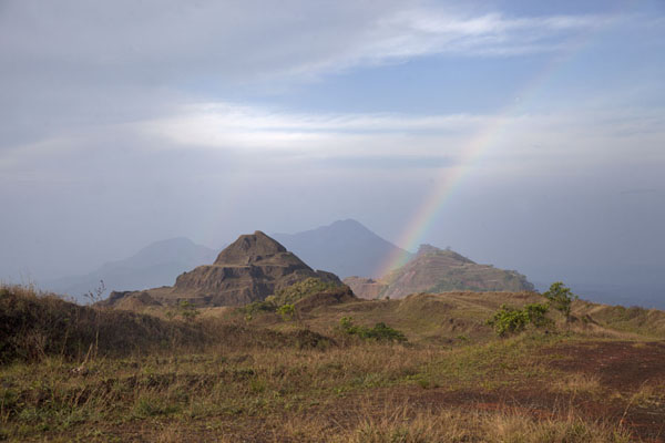 Rainbow over partly sculpted mountains on top of the Mount Nimba ridge | Mount Nimba Liberia | Liberia