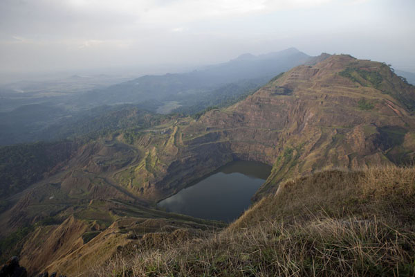 View of the iron ore mining lake, part of the Mount Nimba range, and into Guinea on the left | Mount Nimba Liberia | Liberia