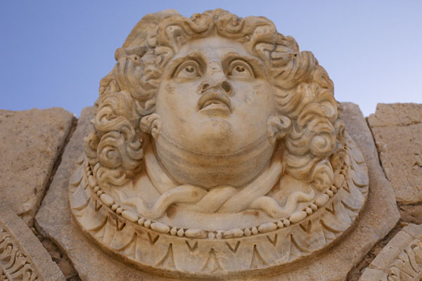 Looking up a medusa head on a lintel in the Severan Forum of Leptis Magna | Leptis Magna | Libye