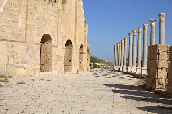 The exterior of the threatre with a row of columns | Leptis Magna | Libye