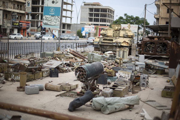 Picture of The sidewalk in front of the war museum has a collection of weapons used by the forces of Gaddafi