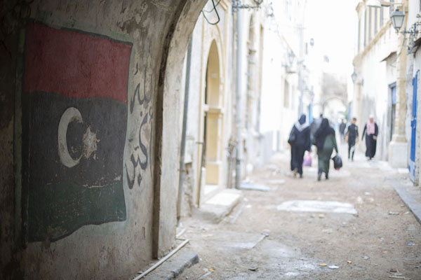 Picture of Old Tripoli (Libya): Street with Libyan flag in the old part of Tripoli