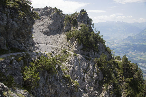 Picture of Looking down Fürstensteig meandering its way up the rocky mountainsFürstensteig - Liechtenstein