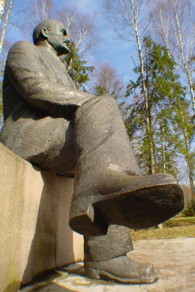 One of the very few statues of Lenin sitting down | Grutas Parkas | Lithuania