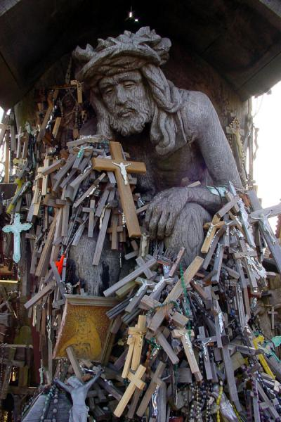 Picture of Hill of Crosses (Lithuania): Statue of Jesus with crosses at Hill of Crosses