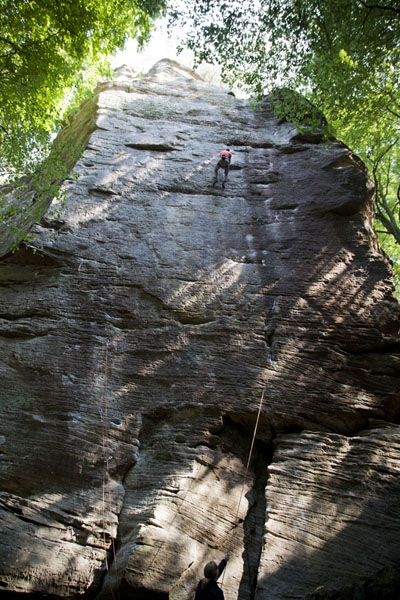 Rock climber working his way up on one of the cliffs | Berdorf rock climbing | Luxembourg