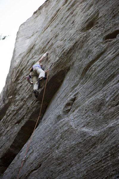 Picture of Climber on one of the many vertical challenges of Berdorf