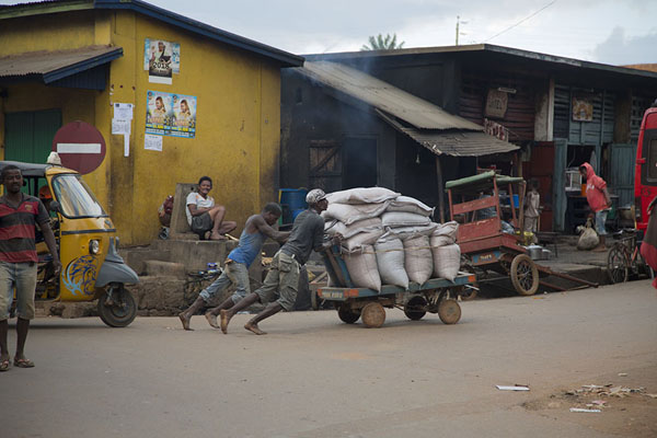 Men pushing a heavy cart to the market in Ambalavao | Ambalavao | Madagascar