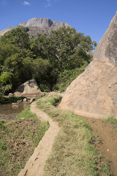 Picture of Trail under a big boulder with one of the Three Sisters in the background - Madagascar