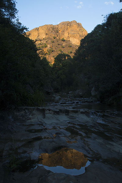 Sunrise on the mountaintop reflected in a river | Isalo National Park | Madagascar