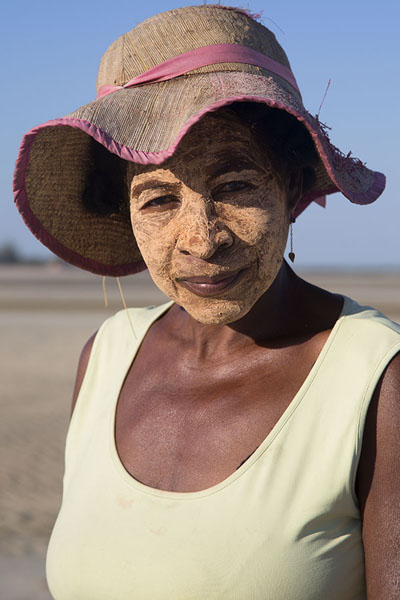 Woman wearing tabaky on the beach of Belo sur Mer | Malagassiers | Madagaskar