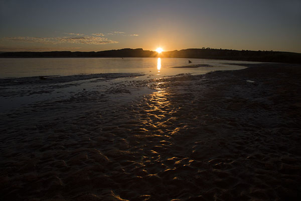 Picture of Sun setting over a sandbank in the Manambolo river