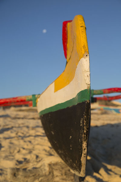 Looking up one of the colourful pirogues on the beach of Salary | Salary | Madagascar