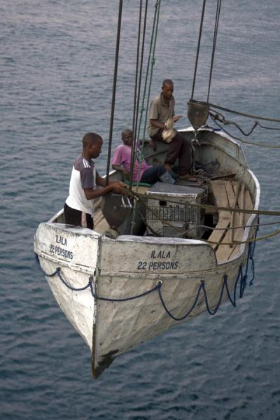 Foto van One of the two small boats hanging from the side of the MV IlalaLake Malawi - Malawi