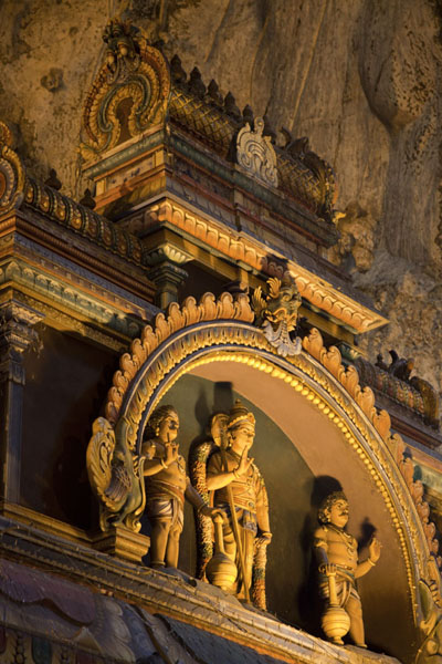 Picture of Batu Caves (Malaysia): Close-up of the sculptures at the top of a temple inside the main cave