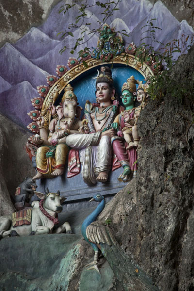 Picture of Batu Caves (Malaysia): Colourful shrine on the face of the rock at the entrance to the Batu Caves