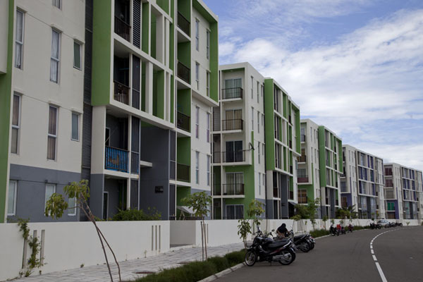 Picture of White and green apartment blocks lining a new street in Hulhumalé