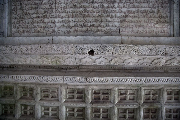 Old Arabic texts engraved in one of the outside coral stone walls of the church | Malé Old Friday Mosque | Maldives