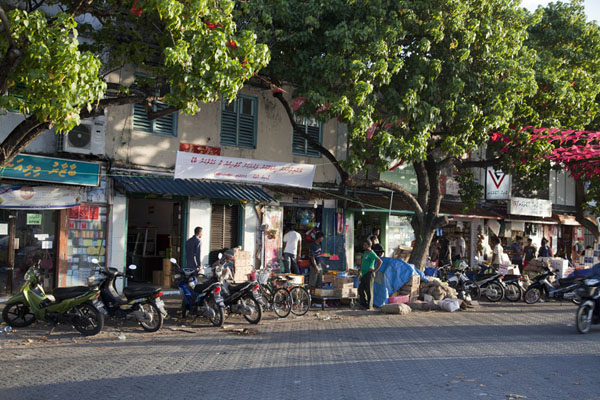 Picture of Malé (Maldives): Shops and parked motorbikes in the late afternoon sun of Malé
