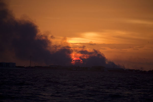 Sunset seen through the smoke of Garbage Island | Ile Viligili | Maldives