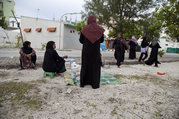 Women gatering on the beach, about to continue canvassing for their candidate in the elections | Ile Viligili | Maldives