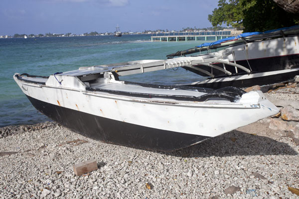 Picture of WAM traditional Marshallese canoes (Marshall Islands): Traditional outrigger canoe lying ashore in Delap