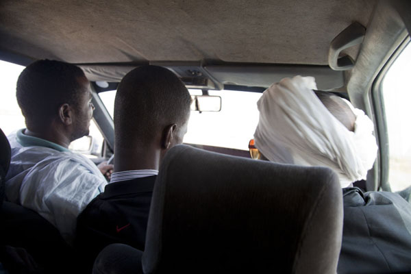 Two passengers on the front seat, responsible for making tea | Nouadhibou Nouakchott taxi ride | Mauritania