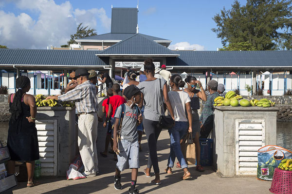 People walking the bridge towards the market of Port Mathurin | Port Mathurin market | Mauritius