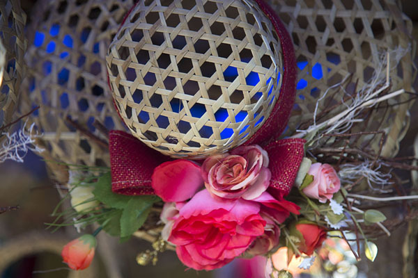 Hat with flowers for sale at the market of Port Mathurin | Mercato Port Mathurin | Maurizio