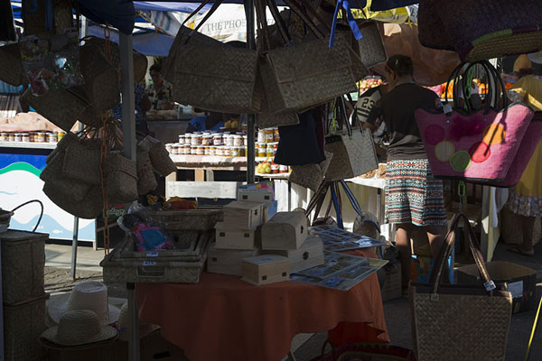 Stall with souvenirs for sale at Port Mathurin market | Mercato Port Mathurin | Maurizio