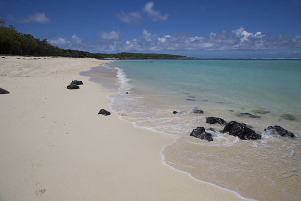 Foto van Black volcanic rock at the beach of Saint FrancoisEast Rodrigues - Mauritius