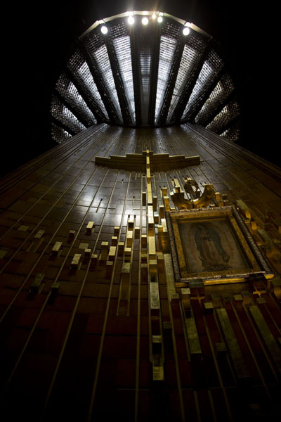 Looking up the wall with the original tilma with the Virgin of Guadalupe in the Basilica | Basílica de Guadalupe | Mexico