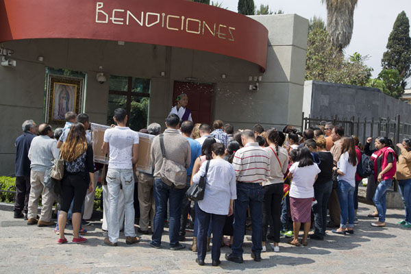 People being blessed by a priest outside the Basilica de Guadalupe | Basílica de Guadalupe | Mexico