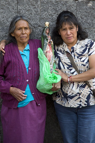 Picture of Mexican women with religious statue waiting to be baptized - Mexico - Americas