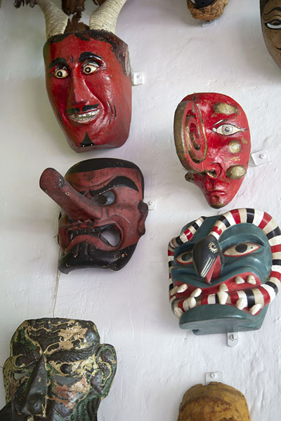 Foto de Curious masks on a wall in the museumCuernavaca - Mexico